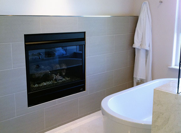Crossville tile featured in a fireplace surround of a master bathroom. Photo courtesy of OurAmericanMadeHome.com